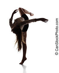 Beautiful slim young female modern jazz contemporary style ballet dancer in silhouette wearing a black leotard and white shirt isolated on a white studio background