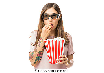Beautiful Female Eating Popcorn While Watching 3D Film