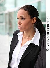 Beautiful female executive outside a corporate building