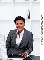 Beautiful female executive working at a computer