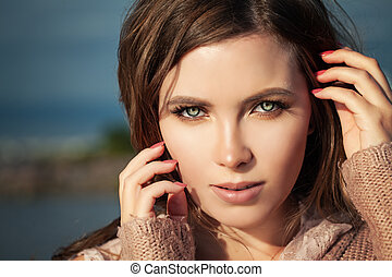 Beautiful Female Face Closeup. Woman with Natural Makeup Outdoors