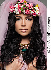 Beautiful Female Face with Flowers. Closeup Fashion Beauty Portrait