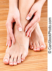 Beautiful female feet and hands with clean and soft skin. Skincare concept