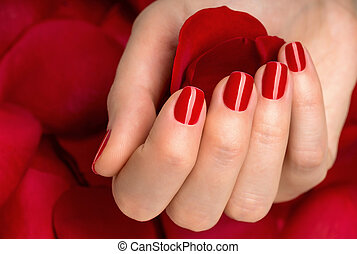Beautiful female finger nails with red nail closeup on ...