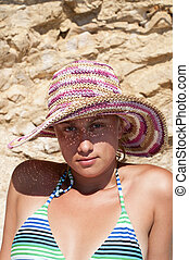 Beautiful female girl with straw hat posing