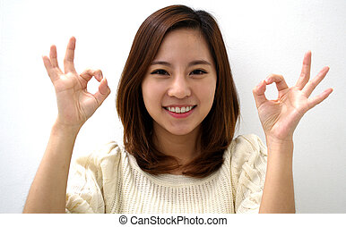Beautiful female giving okay sign