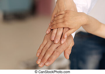 Beautiful female hands being put on each other