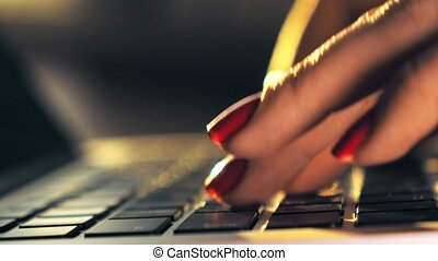 Beautiful female hands typing on laptop keyboard. 4K shallow focus close-up shot