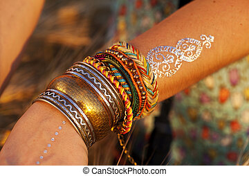 beautiful female hands with bracelets