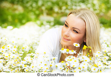 Beautiful female laying on the flower filed - Beautiful...