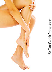 Beautiful female legs and hands. Isolated over white.