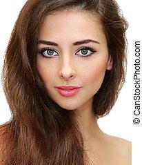 Beautiful female makeup model looking calm. Closeup isolated portrait