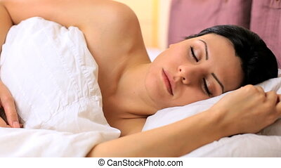 beautiful female model waking up