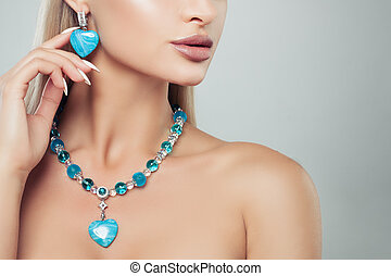 Beautiful female model with turquoise jewelry necklace and earrings