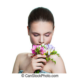 Beautiful female model woman with flowers isolated. Young female model face with healthy skin