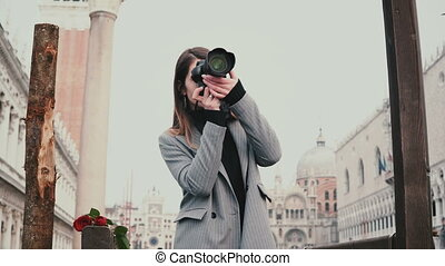 Beautiful female professional photographer with camera...