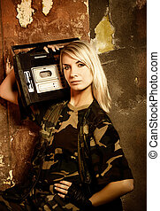 Beautiful female soldier with a retro music player