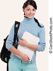 Beautiful female   student posing isolated on a white background