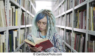 Beautiful female student reading book - Portrait of a...