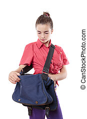 beautiful female student searching in a blue bag, isolated on white