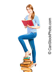 Beautiful female student with a pile of books