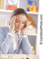 headache - Beautiful female student with headache
