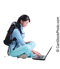 Beautiful female   student working on laptop isolated on a white