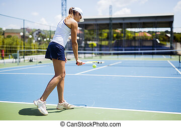 Beautiful female tennis player serving