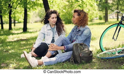 Beautiful female tourists friends in denim clothing are...