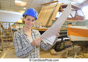 beautiful female worker at a workshop