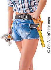 Beautiful female worker with tools in back pocket on shorts on a white background.