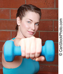 Beautiful Female Working Out With Weights