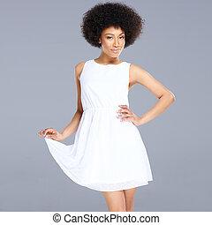 Beautiful feminine African American woman in a fresh white ...