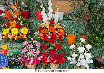 Beautiful festive bouquets in a show-window of flower shop