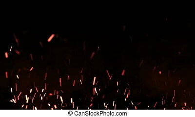 Beautiful fire sparks in the night, dark background. Loop animation.
