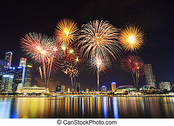 firework over cityscape of Singapore city at night