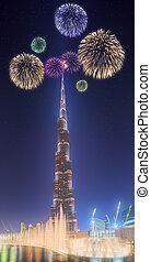 Beautiful fireworks above dancing fountain Burj Khalifa in...