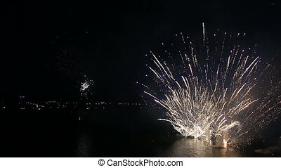 Beautiful fireworks on the river in night sky.