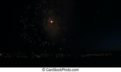 Beautiful fireworks on the river in night sky. Time Lapse