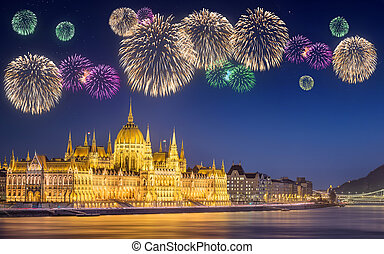 Beautiful fireworks under hungarian Parliament building at night in Budapest, Hungary