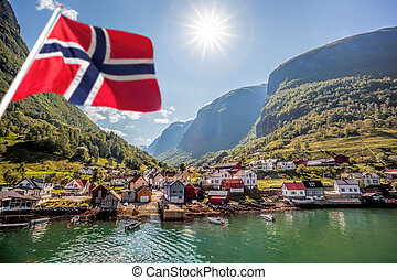 Beautiful Fishing village Undredal against mountain near the...