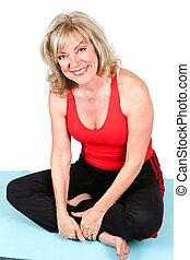 Beautiful Fit Senior on Yoga Mat