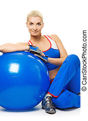 Beautiful fitness trainer with a ball