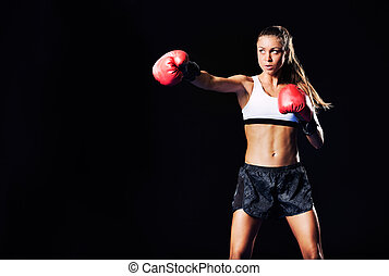 Beautiful Fitness Woman Boxing with Red Gloves - Beautiful...