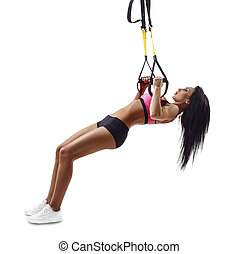 Beautiful fitness woman do Inverted Row with trx suspensions