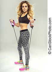 Beautiful fitness woman working out.