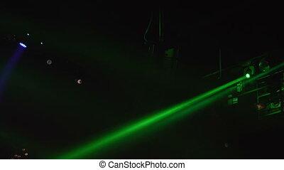 Beautiful flickering in darkness disco lights background....