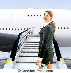 flight attendant near moving ramp - beautiful flight ...