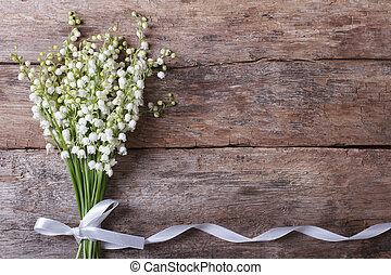 Beautiful floral frame with lilies of the valley flowers on ...