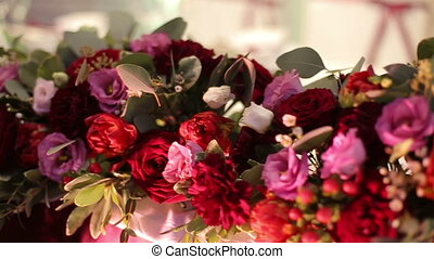 Beautiful floral wedding decorations. Wonderful flowers are on the table close-up